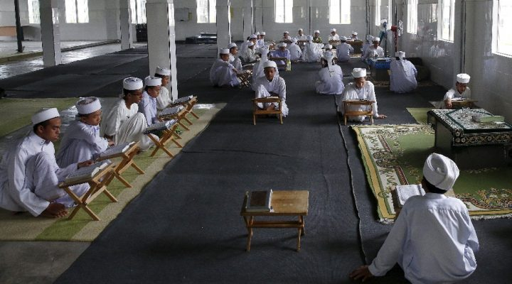 """Tahfiz or Koranic students recite the Koran in Madrasah Nurul Iman boarding school outside Malaysia's capital city, Kuala Lumpur, September 11, 2015. There are 36 male students at the madrasah, ranging from 11 to 18 years of age. Nearly three years after Taliban gunmen shot Pakistani schoolgirl Malala Yousafzai, the teenage activist last week urged world leaders gathered in New York to help millions more children go to school. World Teachers' Day falls on 5 October, a Unesco initiative highlighting the work of educators struggling to teach children amid intimidation in Pakistan, conflict in Syria or poverty in Vietnam. Even so, there have been some improvements: the number of children not attending primary school has plummeted to an estimated 57 million worldwide in 2015, the U.N. says, down from 100 million 15 years ago. Reuters photographers have documented learning around the world, from well-resourced schools to pupils crammed into corridors in the Philippines, on boats in Brazil or in crowded classrooms in Burundi.    REUTERS/Olivia HarrisPICTURE 37 OF 47 FOR WIDER IMAGE STORY """"SCHOOLS AROUND THE WORLD""""SEARCH """"EDUCATORS SCHOOLS"""" FOR ALL IMAGES - RTS2DWH"""